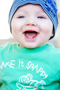 Closeup of beautiful happy baby with blue eyes