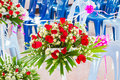 Closeup beautiful wedding flower arrangement of seats along the Royalty Free Stock Photo