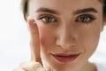 Closeup Of Beautiful Woman Applying Eye Lens In Eye Royalty Free Stock Photo