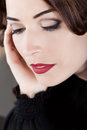Closeup beautiful woman red lips looking down Stock Photo