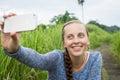 Closeup of beautiful woman taking a selfie on smart phone outdoo Royalty Free Stock Photo