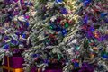 Closeup of beautifully decorated colorful Christmas trees