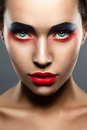 Closeup beauty creative makeup woman face red and blue Stock Image