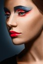 Closeup beauty creative makeup woman face red and blue Stock Photos
