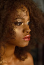 Closeup beauty portrait of young african american girl with gold and glamour makeup Royalty Free Stock Photo
