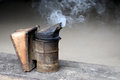 Closeup of bee smoker on crate at farm Royalty Free Stock Image