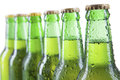 Closeup of beer bottles with water drops isolated on white Stock Photo