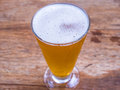 Closeup beer glass on wood background Royalty Free Stock Photo