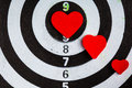 Closeup black white target with hearts bullseye as love background Royalty Free Stock Photo