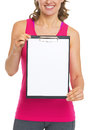 Closeup on blank clipboard in hand of fitness woman isolated white Stock Photography