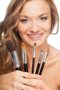 Closeup blonde woman holding set of brushes Stock Photography