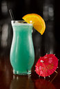 Closeup blue hawaiian cocktail out focus bar top Stock Photography