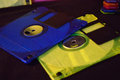 Closeup of blue and yellow green floppy disk Royalty Free Stock Photo