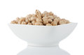 Closeup of a bowl with chickpeas on white background Royalty Free Stock Photos