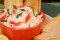 Closeup of a bowl of crab dip with toasted crostini and lemon Royalty Free Stock Photos