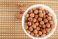 Closeup bowl many peeled hazelnuts Royalty Free Stock Photos
