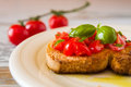 Closeup of bruschetta with tomato and basil Royalty Free Stock Photo