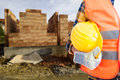 Closeup of builder man holding helmet Royalty Free Stock Photo