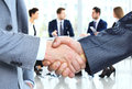 Closeup of a business handshake business people shaking hands finishing up meeting Royalty Free Stock Photography