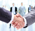 Closeup of a business handshake business people shaking hands finishing up meeting Stock Image