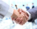 Closeup of a business handshake in the office Stock Photo