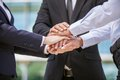 Closeup of business team holding hands together close up three on top each other Stock Photography