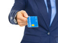 Closeup on business woman giving credit card isolated white Stock Image