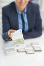Closeup on business woman giving money packs happy Royalty Free Stock Photos