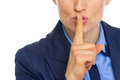 Closeup on business woman showing shh gesture Royalty Free Stock Photo