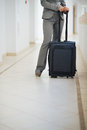 Closeup on business woman standing with wheel bag Stock Photos