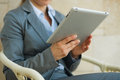 Closeup on business woman using tablet PC Royalty Free Stock Image