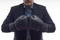 Closeup businessman in boxing gloves isolated on portrait of black white background Royalty Free Stock Photos