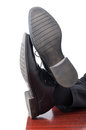 Closeup of businessman feet with leather shoes Royalty Free Stock Photo