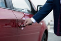 Closeup of businessman hand opening car door Royalty Free Stock Photo