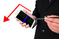 Closeup of a businessman s hands with pocketpc isolated red down arrow for stock concept Royalty Free Stock Image