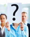 Closeup of businesspeople holding question mark Stock Images
