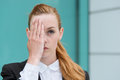 Closeup of businesswoman covering eye portrait a serious young an Royalty Free Stock Photo