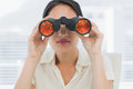 Closeup of a businesswoman looking through binoculars Stock Image