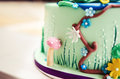 Closeup of cake decorated with sugar figurines Royalty Free Stock Photo