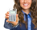 Closeup on calculator in hand of smiling business woman isolated white Stock Photography