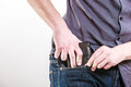 Closeup careless man putting wallet in his pocket theft of male hands the risk of isolated on white studio shot Royalty Free Stock Photo