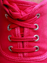 Closeup of casual vibrant pink sneakers shoes boots on female feet Royalty Free Stock Images