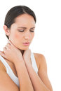 Closeup of a casual woman suffering from neck ache young over white background Royalty Free Stock Image