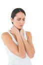 Closeup of a casual woman suffering from neck ache young over white background Royalty Free Stock Photos