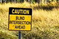 Closeup of a Caution Blind Intersection Ahead sign Royalty Free Stock Photo