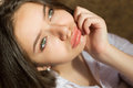 Closeup of charming girl pouting lips and looking Royalty Free Stock Photo