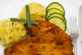 Closeup chicken fried schnitzel mashed potatoes cucumber white plate Stock Image
