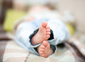 Closeup child feet who sleeping bed Stock Photo