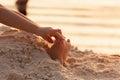 Closeup child kid feet on white sand beach. Royalty Free Stock Photo