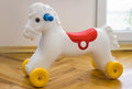 Closeup of a chilldren toy horse with wheels.On the floor. Royalty Free Stock Photo